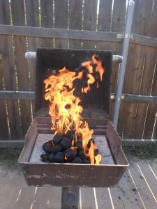 Lit charcoal.
